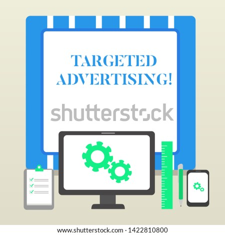 Handwriting text Targeted Advertising. Concept meaning Online Advertisement Ads based on consumer activity Business Concept PC Monitor Mobile Device Clipboard Ruler Ballpoint Pen.