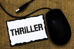 Handwriting text Thriller. Concept meaning Chilling frightful moments in life film and movie category USB black mouse art board paper ideas thoughts ideas designs mat shadow.