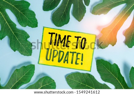 Handwriting text Time To Update. Concept meaning act updating something someone or updated version program Leaves surrounding notepaper above an empty soft pastel table as background. #1549241612
