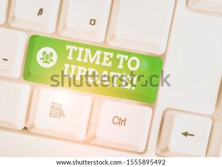 Handwriting text Time To Update. Concept meaning act updating something someone or updated version program White pc keyboard with empty note paper above white background key copy space. #1555895492