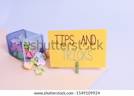 Handwriting text Tips And Tricks. Concept meaning piece of inside facts specially in betting or investing Trash bin crumpled paper clothespin empty reminder office supplies tipped.