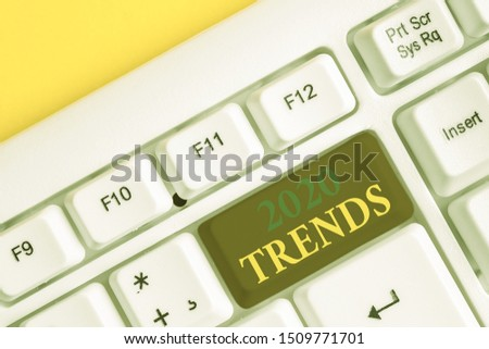 Handwriting text 2020 Trends. Concept meaning things that is famous for short period of time in current year White pc keyboard with empty note paper above white background key copy space.