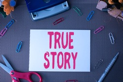 Handwriting text True Story. Concept meaning The day to day experiences of an individual in his entire life Scissors and writing equipments plus plain sheet above textured backdrop.