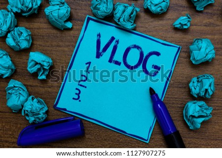 Handwriting text Vlog. Concept meaning Entertaining multimedia self broadcasting news reporting stories Cyan paper imagination idea thoughts mistakes several tries marker pen.