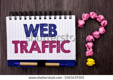Handwriting text Web Traffic. Concept meaning Internet Boost Visitors Audience Visits Customers Viewers written on Notebook Book on the wooden background Pen and Question Mark next to it. #1065639305
