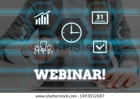 Handwriting text Webinar. Concept meaning a seminar or other presentation that takes place on the Internet Woman wear formal work suit presenting presentation using smart device. #1493012687