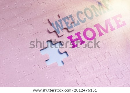 Handwriting text Welcome Home. Internet Concept Expression Greetings New Owners Domicile Doormat Entry Building An Unfinished White Jigsaw Pattern Puzzle With Missing Last Piece Stock photo ©