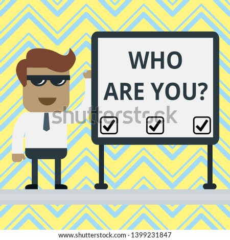 Handwriting text Who Are You Question. Concept meaning asking about someone identity or demonstratingal information.