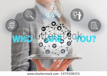 Handwriting text Who Are You question. Concept meaning asking demonstrating identity or demonstratingal information Male human wear formal work suit presenting presentation using smart device.