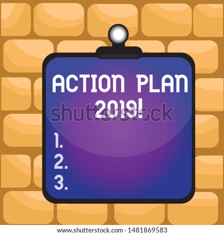 Handwriting text writing Action Plan 2019. Concept meaning proposed strategy or course of actions for current year Clipboard colorful background spring clip stuck bind empty plank frame.