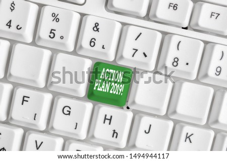 Handwriting text writing Action Plan 2019. Concept meaning proposed strategy or course of actions for current year White pc keyboard with empty note paper above white background key copy space.