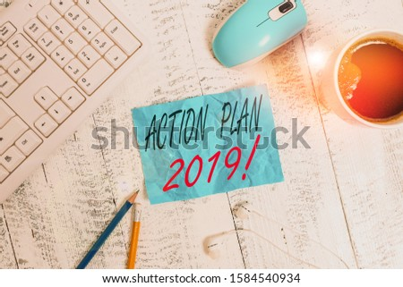 Handwriting text writing Action Plan 2019. Concept meaning proposed strategy or course of actions for current year technological devices colored reminder paper office supplies keyboard mouse.