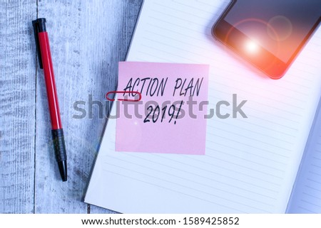Handwriting text writing Action Plan 2019. Concept meaning proposed strategy or course of actions for current year Thick pages notebook stationary placed above classic look wooden backdrop.