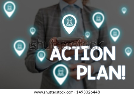 Handwriting text writing Action Plan. Concept meaning proposed strategy or course of actions for certain time Woman wear formal work suit presenting presentation using smart device.
