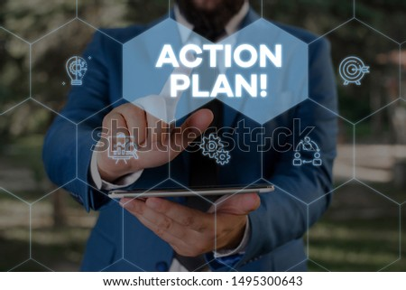 Handwriting text writing Action Plan. Concept meaning proposed strategy or course of actions for certain time Male human wear formal work suit presenting presentation using smart device.