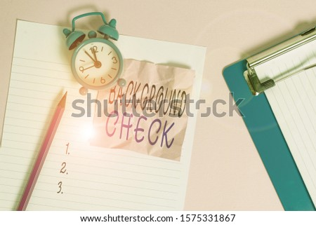 Handwriting text writing Background Check. Concept meaning investigation into a demonstrating s is origins and previous history Paper sheet note clipboard pencil vintage alarm clock colored background #1575331867