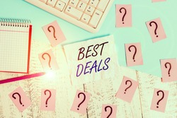 Handwriting text writing Best Deals. Concept meaning very successful transaction or business agreement or a bargain Writing tools, computer stuff and math book sheet on top of wooden table.