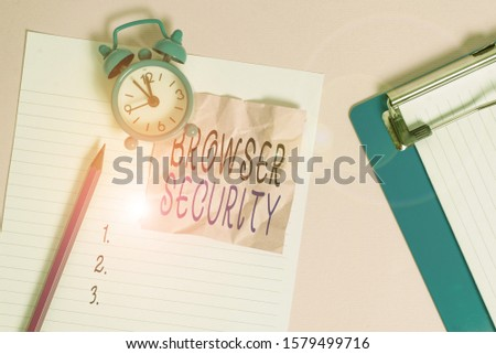 Handwriting text writing Browser Security. Concept meaning security to web browsers in order to protect networked data Paper sheet note clipboard pencil vintage alarm clock colored background.