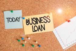 Handwriting text writing Business Loan. Concept meaning Credit Mortgage Financial Assistance Cash Advances Debt Corkboard color size paper pin thumbtack tack sheet billboard notice board.