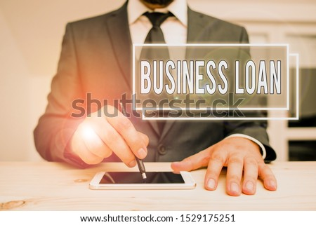 Handwriting text writing Business Loan. Concept meaning Credit Mortgage Financial Assistance Cash Advances Debt.
