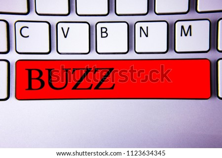 Handwriting text writing Buzz. Concept meaning Hum Murmur Drone Fizz Ring Sibilation Whir Alarm Beep Chime Keyboard red key Intention create creating message idea communicate paper.