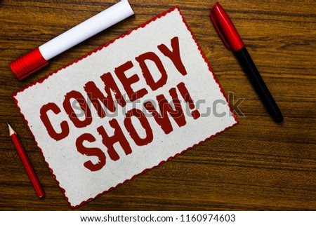 Handwriting text writing Comedy Show. Concept meaning Funny program Humorous Amusing medium of Entertainment White paper red borders markers wooden background communicating ideas.