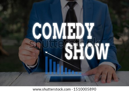 Handwriting text writing Comedy Show. Concept meaning Funny program Humorous Amusing medium of Entertainment Male human wear formal work suit presenting presentation using smart device. #1510005890