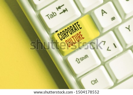 Handwriting text writing Corporate Culture. Concept meaning pervasive values and attitudes that characterize a company White pc keyboard with empty note paper above white background key copy space. #1504178552