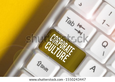 Handwriting text writing Corporate Culture. Concept meaning pervasive values and attitudes that characterize a company White pc keyboard with empty note paper above white background key copy space.
