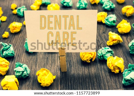 Handwriting text writing Dental Care. Concept meaning maintenance of healthy teeth or to keep it clean for future Clothespin holding light pink note paper crumpled papers several tries.