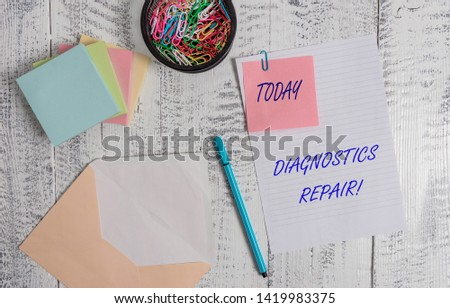 Handwriting text writing Diagnostics Repair. Concept meaning A program or routine that helps a user to identify errors Envelope sheet paper sticky note pads pen clips holder wooden background. #1419983375