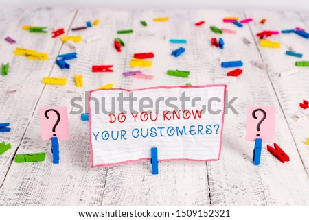 Handwriting text writing Do You Know Your Customers question. Concept meaning asking to identify a customer s is nature Scribbled and crumbling sheet with paper clips placed on the wooden table.