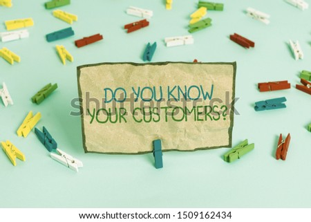 Handwriting text writing Do You Know Your Customers question. Concept meaning asking to identify a customer s is nature Colored clothespin papers empty reminder blue floor background office pin.