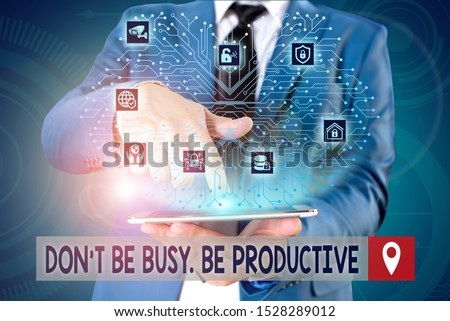 Handwriting text writing Don T Be Busy Be Productive. Concept meaning Work efficiently Organize your schedule time Male human wear formal work suit presenting presentation using smart device. #1528289012