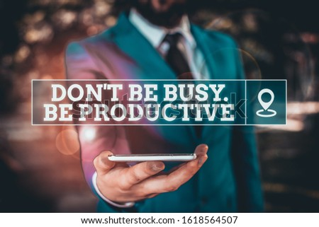 Handwriting text writing Don T Be Busy Be Productive. Concept meaning Work efficiently Organize your schedule time Businessman in blue suite stands with mobile phone in hands.