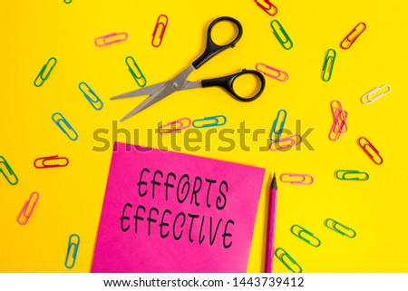 Handwriting text writing Efforts Effective. Concept meaning Produces the results as per desired Goal Target Achieve Blank colored paper sheet scissors pencil clips light color background.