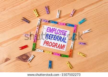 Handwriting text writing Employee Referral Program. Concept meaning internal recruitment method employed by organizations Colored clothespin papers empty reminder wooden floor background office. #1507502273