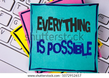 Handwriting text writing Everything Is Possible. Concept meaning All you think or dream can become true Optimistic written Sticky note paper placed Laptop Keyboard Sticky Note papers. #1072952657