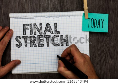 Handwriting text writing Final Stretch. Concept meaning Last Leg Concluding Round Ultimate Stage Finale Year ender Open notebook clothespin holding reminder clothespins clips wooden table. #1168343494