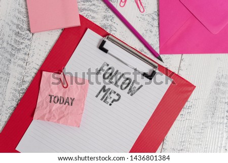 Handwriting text writing Follow Me Question. Concept meaning go or come after demonstrating or thing proceeding ahead Clipboard sheet pencil crushed note envelope clips notepad wood background. #1436801384
