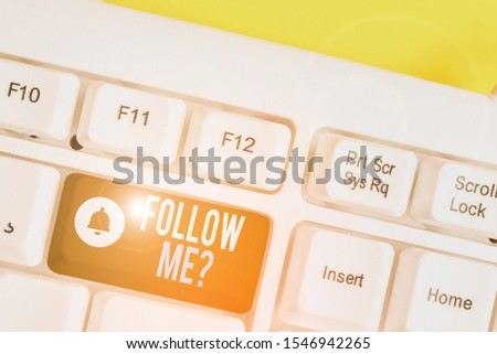 Handwriting text writing Follow Me Question. Concept meaning go or come after demonstrating or thing proceeding ahead White pc keyboard with empty note paper above Yellow  background key copy space. #1546942265