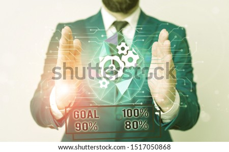 Handwriting text writing Goal 100 Percent 90 Percent 80 Percent. Concept meaning Percentage of your objectives fulfilment success level Male human wear formal work suit presenting presentation using