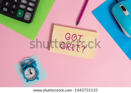Handwriting text writing Got Grit Question. Concept meaning A hardwork with perseverance towards the desired goal Mouse calculator sheets marker notepad alarm clock colored background.