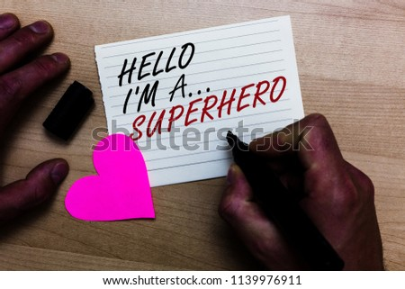 Handwriting text writing Hello I am A ... Superhero. Concept meaning Special powers Cartoon character Customs strenght Written on notepad hand hold marker with love heart wooden background. #1139976911