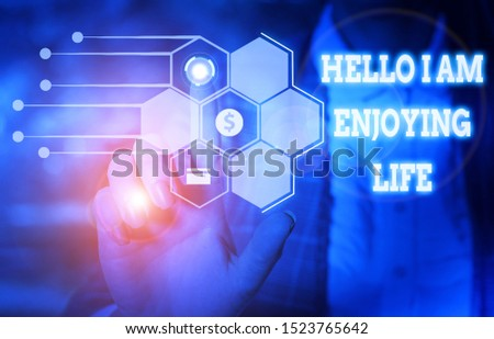 Handwriting text writing Hello I Am Enjoying Life. Concept meaning Happy relaxed lifestyle Enjoy simple things Woman wear formal work suit presenting presentation using smart device.