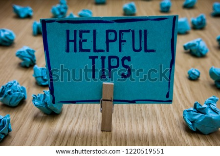 Handwriting text writing Helpful Tip s is. Concept meaning Ask an Expert Solutions Hints Consulting Warning Clothespin holding blue paper note crumpled papers several tries mistakes.