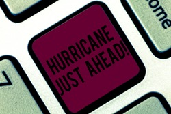 Handwriting text writing Hurricane Just Ahead. Concept meaning violent tropical cyclone is approaching to hit the land Keyboard key Intention to create computer message pressing keypad idea.