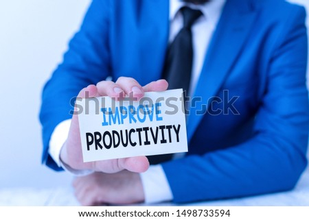 Handwriting text writing Improve Productivity. Concept meaning to increase the machine and process efficiency Man holds empty paper with copy space in front of him Space.