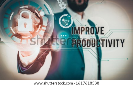 Handwriting text writing Improve Productivity. Concept meaning to increase the machine and process efficiency Male human wear formal work suit presenting presentation using smart device.