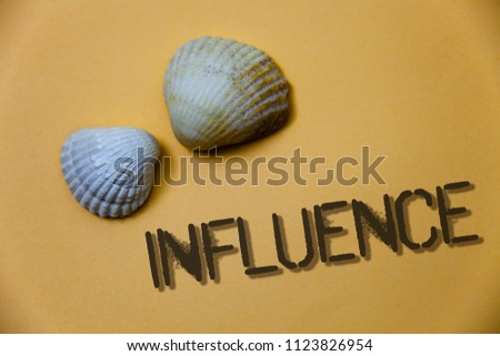 Handwriting text writing Influence. Concept meaning Capacity to have effect on others character development behavior Grunge ideas messages shells light brown background beach memories thoughts.